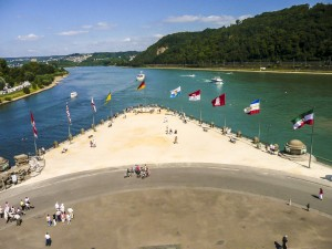 KOBLENZ, GERMANY-AUG 23, 2009: Confluence of Rhine and Mosel rivers. Deutsches Eck German Corner is the name of a headland where the Moselle joins the Rhine in Koblenz, Germany